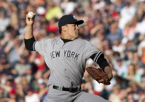 July 8, 2014: New York Yankees starting pitcher Masahiro Tanaka (19) pitches in the first inning during the game between the New York Yankees and the Cleveland Indians at Progressive Field in Cleveland, Ohio, USA.